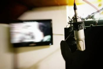 Recording with studio microphone at Sound Guru Studios